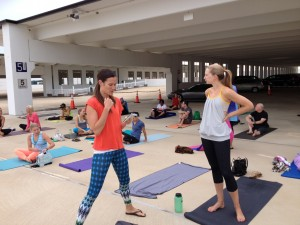 With friends waiting for rooftop yoga to begin.