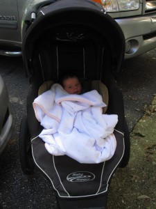 Baby A in the Baby Jogger FIT for the first time; she's just shy of being one month old.